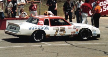 The RahMoc Enterprises-owned #75 Chevy, driven by Neil Bonnett, at the 1983 Van Scoy 500. Bonnett finished 7th and led 6 laps. (us44mt, Wikipedia)
