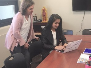 Amrita Lakhanpal, seated, has dedicated herself to getting Birmingham elementary students the technological tools they need to prepare for their futures. (Karim Shamsi-Basha/Alabama NewsCenter)