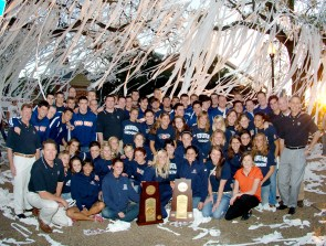 """The 2006 men's and women's AU championship swim teams pose at Toomer's Corner. Although football garners the most attention at Auburn, its swimming teams consistently finish at the top of their sport. A number of Auburn swimmers have medalled in the Olympics, including three-time gold-medalists Kristy Coventry and Ambrose """"Rowdy"""" Gaines. (From Encyclopedia of Alabama, courtesy of Auburn University Photographic Services)"""