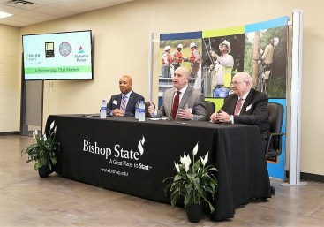Bishop State Community College and Alabama Power have agreed to create a lineman training program. Signing the agreement are, from left, Dr. Reginald Sykes president of Bishop State Community College; Jeff Peoples, Alabama Power senior vice president of Employee Services and Labor Relations; and Jimmy Baker, chancellor of the Alabama Community College System. (Mike Kittrell / Alabama NewsCenter)