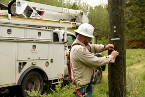 An Alabama Power lineman tags a new utility pole on Friday following Thursday night's storm. (Phil Free/Alabama NewsCenter)