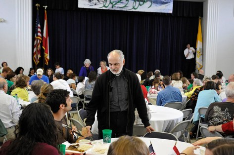 Chorbishop Richard Saad welcomes guests to the St. Elias Food Festival. (Contributed)