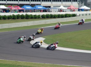 Motorcyclists compete in a race at the 2.3-mile track next to the Barber Vintage Motorsports Museum. The museum occasionally races some of the vintage motorcycles from its collection on the track. (From Encyclopedia of Alabama, courtesy of Barber Vintage Motorsports Museum)