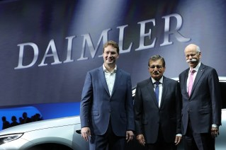 Ola Kallenius, incoming chief executive officer of Daimler AG, left, Manfred Bischoff, chairman of Daimler AG, center, and Dieter Zetsche, outgoing chief executive officer of Daimler AG, pose for photographs during the automaker's annual general meeting in Berlin. (Krisztian Bocsi/Bloomberg)