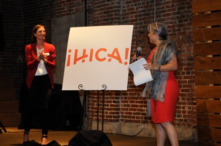 Isabel Rubio of the Hispanic Interest Coalition of Alabama unveils the organization's new logo. (Karim Shamsi-Basha/Alabama NewsCenter)