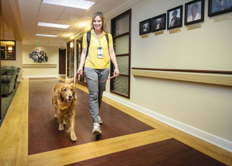 Casey Schaffer and therapy dog Bogey bring joy to very ill patients. (Holly Gainer)