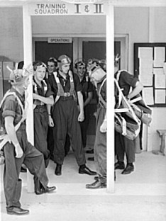 Army Air Corps Cadets are seen before a training flight at Craig Field, Southeastern Air Training Center, in Selma, Dallas County, in August 1941. (From Encyclopedia of Alabama, Library of Congress, photograph by John Collier)