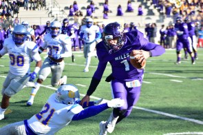 Quarterback Daniel Smith (1) scrambles to elude a tackler. (Miles College Athletics)