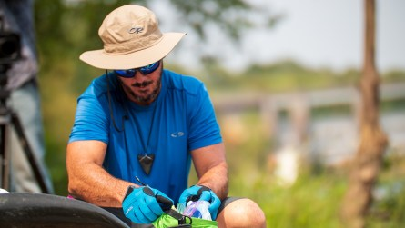 Bobby Johnson prepares to get back in the water after the first portage. (Dennis Washington / Alabama NewsCenter)
