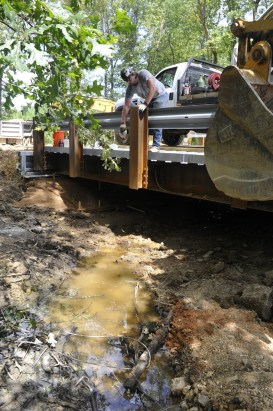 Workers install a bridge over St. Clair County's Little Canoe Creek. (Karim Shamsi-Basha/Alabama NewsCenter)