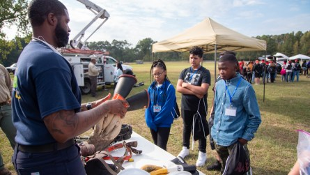 Students learn about some of the tools linemen use to stay safe. (Dennis Washington / Alabama NewsCenter)