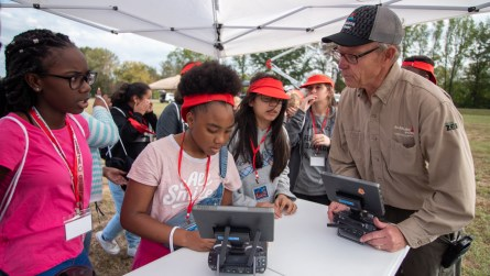 Students learn about different types of drones. (Dennis Washington / Alabama NewsCenter)