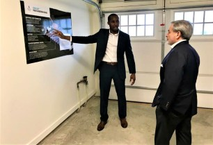Southern Company Research and Development's Olu Ajala, left, briefs Deputy Energy Secretary Dan Brouillette on Alabama Power's Smart Home and Reynolds Landing Smart Neighborhood. (Michael Sznajderman / Alabama NewsCenter)