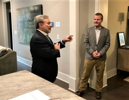 Deputy Energy Secretary Dan Brouillette, left, talks in the Alabama Power Smart Home in Reynolds Landing Smart Neighborhood. (Michael Sznajderman / Alabama NewsCenter)