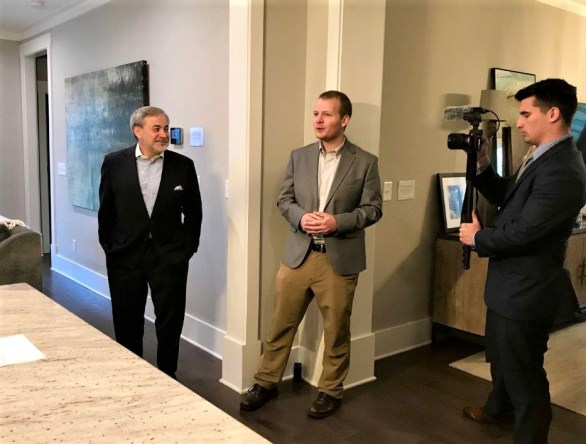 Deputy Energy Secretary Dan Brouillette, left, looks on as Southern Company Research and Development's Jim Leverette, center, talks in the Alabama Power Smart Home in Reynolds Landing Smart Neighborhood. (Michael Sznajderman / Alabama NewsCenter)