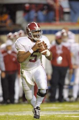 Quarterback Andrew Zow of Alabama looks for an opening to throw a pass against Iowa State during the Independence Bowl game at Independence Stadium in Shreveport, Louisiana. Alabama won 14-13. DIGITAL IMAGE. (Ronald Martinez/Getty Images)