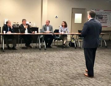 John Northington, Director of the National Carbon Capture Center, briefs a group including U.S. Sens. Doug Jones and Joe Manchin. (Michael Sznajderman/Alabama NewsCenter)