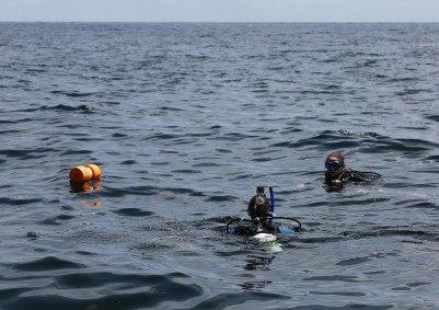Divers prepare to descend to an artificial reef created in 2016. (Mike Kittrell)