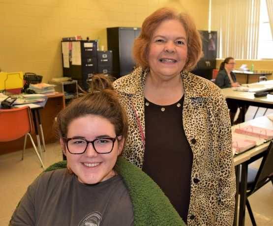 A Bevill State Community College instructor (right) helps the women learn business skills. (Donna Cope/Alabama NewsCenter)