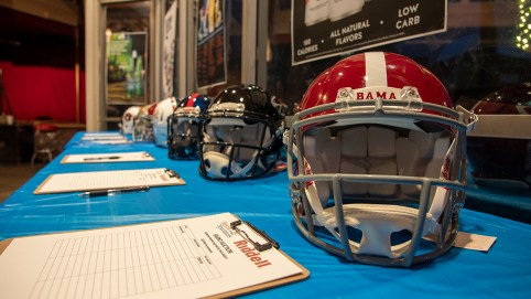 Several autographed helmets were auctioned Thursday as part of the fundraiser. (Dennis Washington / Alabama NewsCenter)