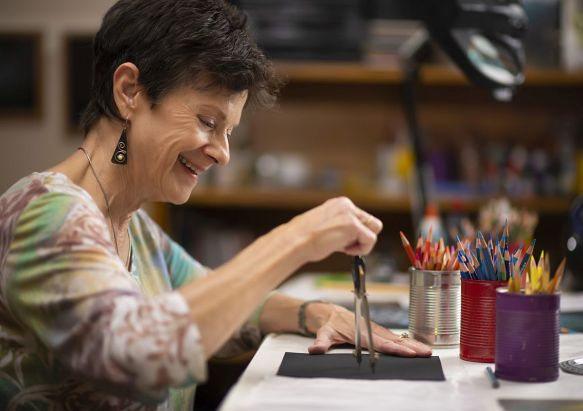 Sharon Cook enjoys creating mandala art indoors. (Phil Free/Alabama NewsCenter)