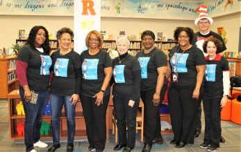Alabama Power Service Organization volunteers, from left, Tionne Robinson, Valencia Chaney, Michelle Stevenson, Joyce Boshell, Pat Sims, Monica Mabien, Marilyn Nelson and Jacob Godwin, participated in Read Across America at Craighead Elementary School. (contributed)