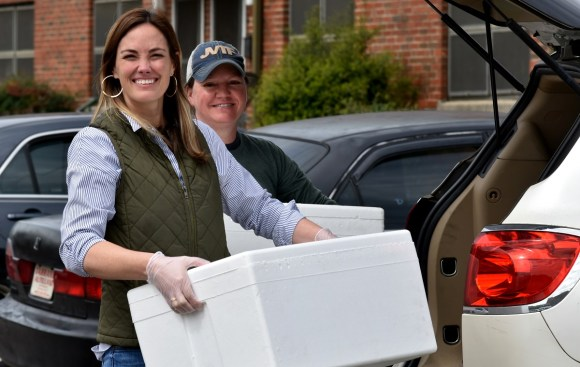 Nourish Foods owners Mary Drennen, left, and Tiffany Davis deliver microwavable meals and snacks to Southtown public housing community. (Solomon Crenshaw Jr./Alabama NewsCenter)