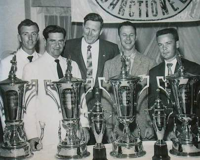 Red Farmer, left, with his 1956 NASCAR Modified Championship trophy in Daytona for the NASCAR awards banquet, along with builder of the Talladega Superspeedway and NASCAR President Bill France Sr., center. Other champions Buck Baker, Jim Reed and Bob Welborn are also shown. (Talladega Superspeedway)