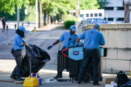 CAP workers clean up the streets in downtown Birmingham today after a protest Sunday evening. (Marvin Gentry/The Birmingham Times)