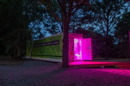 The converted, high-tech shipping containers are lit inside with red and blue LED lights, which the plants use for photosynthesis. (Auburn University)