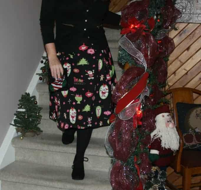 Black wedge boots and a christmas skirt
