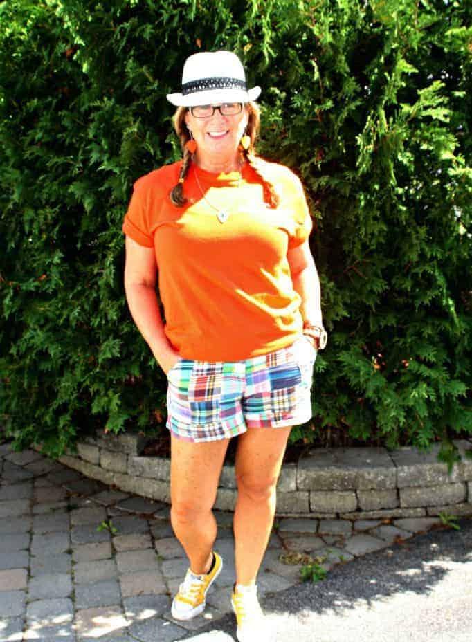 Orange shirt for NDP and plaid shorts with fedora