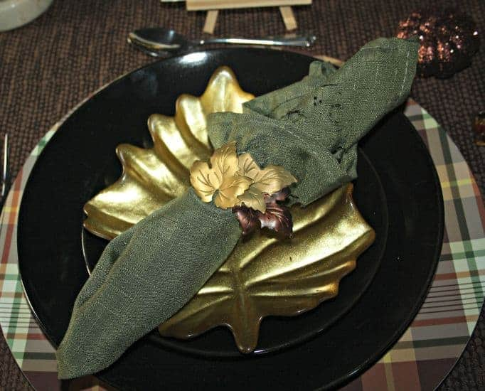 gold leaf plate and napkin ring with plaid charger
