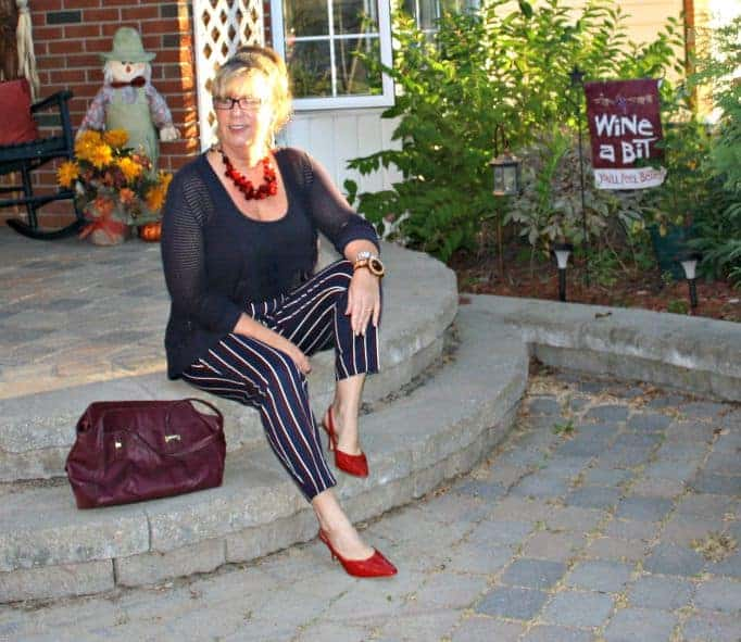 wine coach bag and harper striped pants