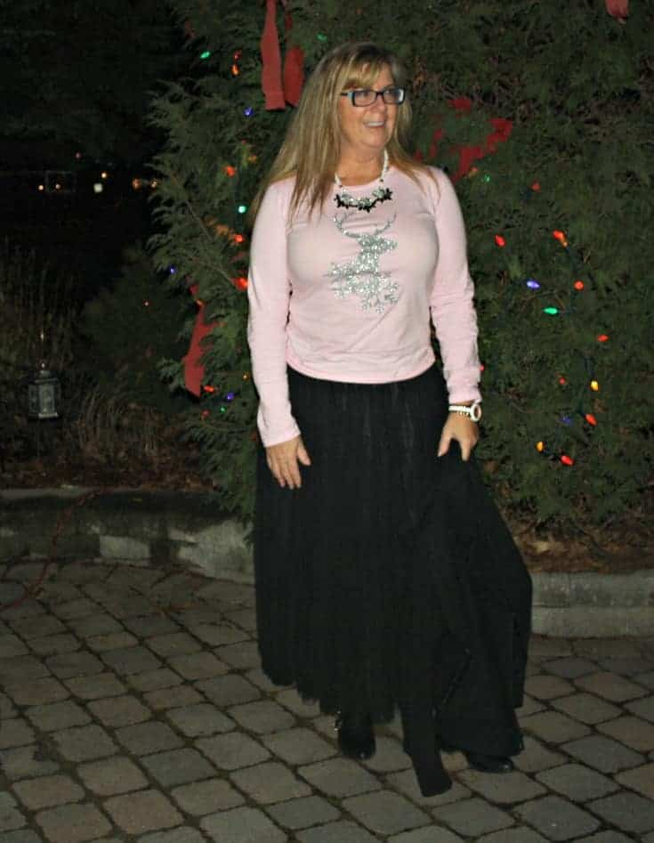 Glitter Reindeer shirt with a black tulle skirt and a moto jacket 13