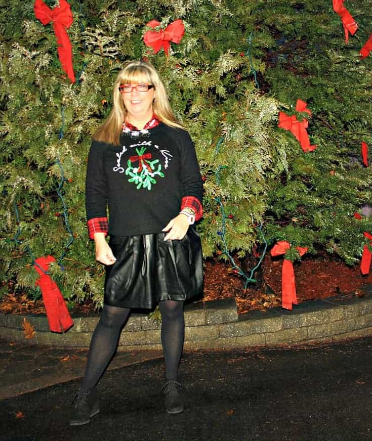H&M Christmas sweater with flannel and a leather skirt, wedge boots by George