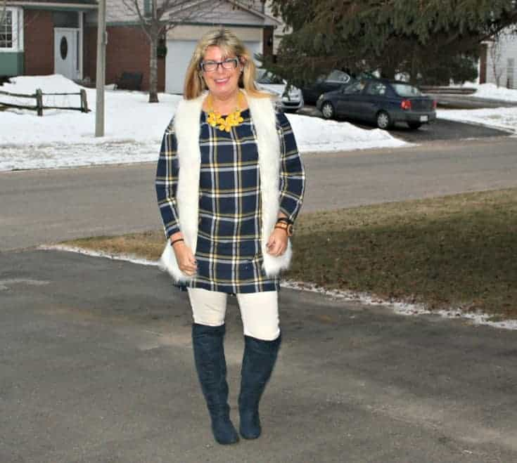 old navy blue plaid dress and white fur vest and blue suede boots with white denim in winter