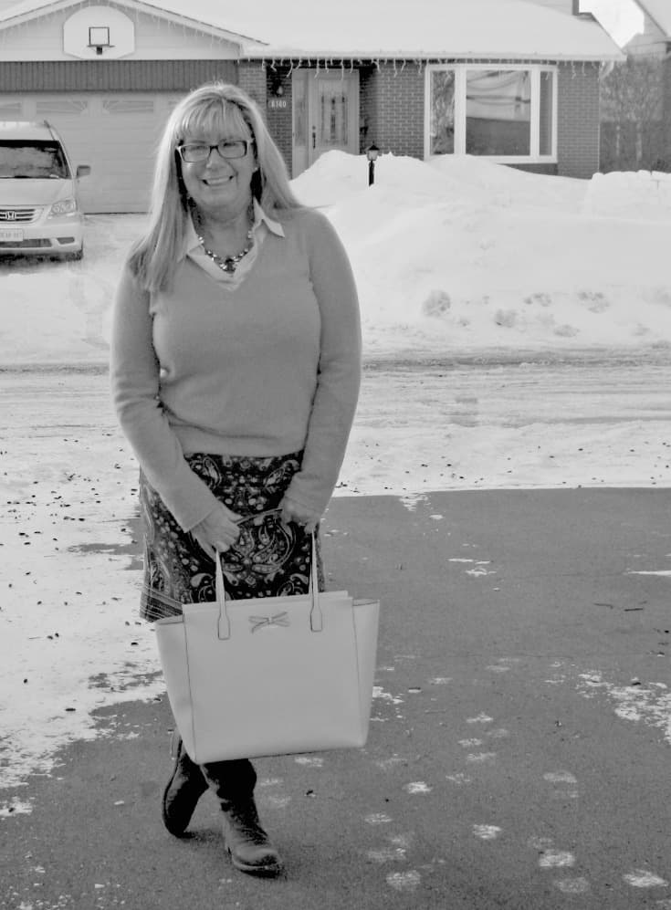 Paisley skirt with a pink cashmere sweater and kate spade bag in B&W