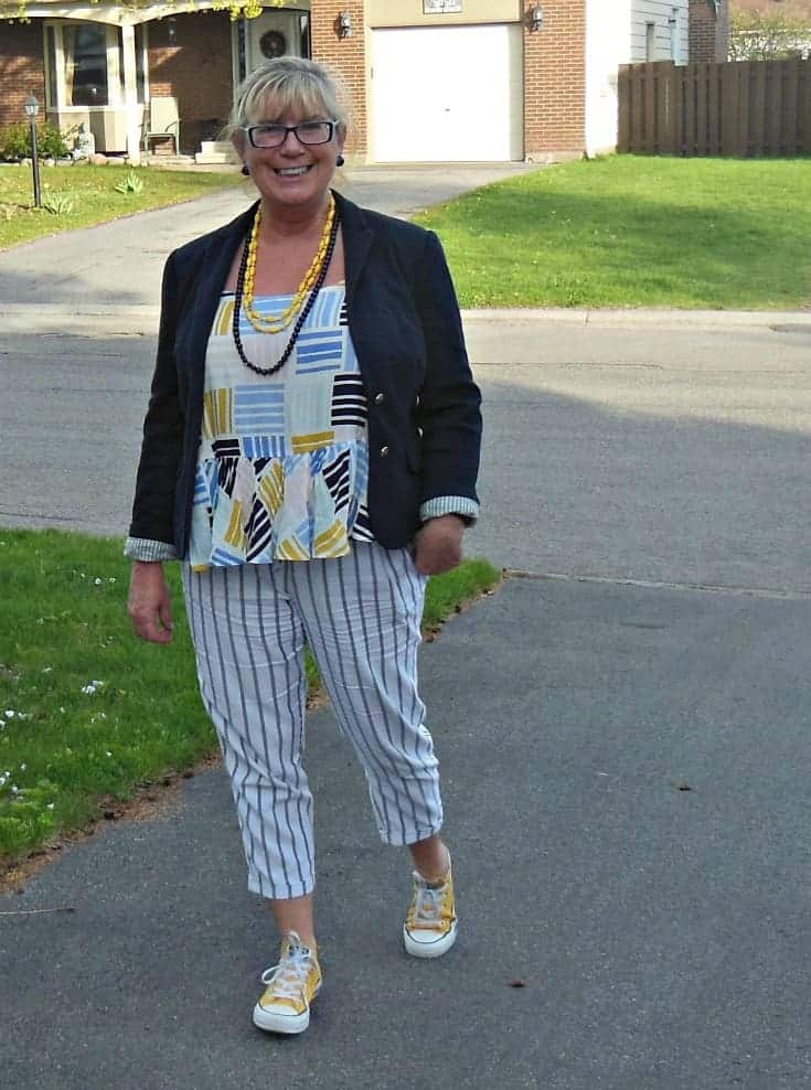 Old Navy linen cropped pants, a peplum top and a navy blazer. Yellow converse and some fun beads