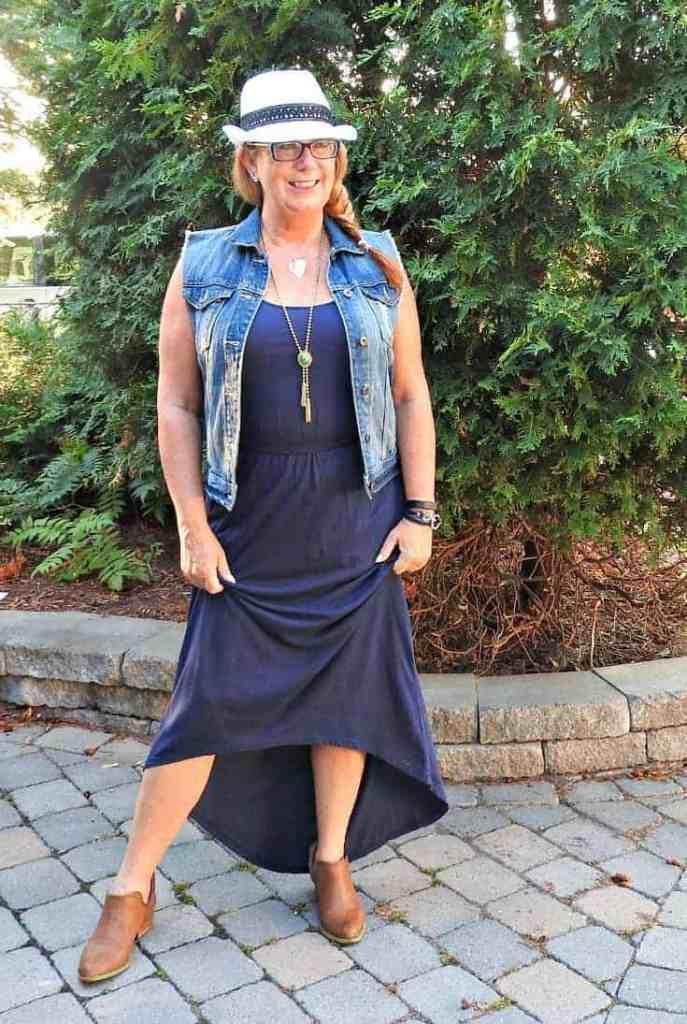 hi lo dress with denim vest, a fedora and booties