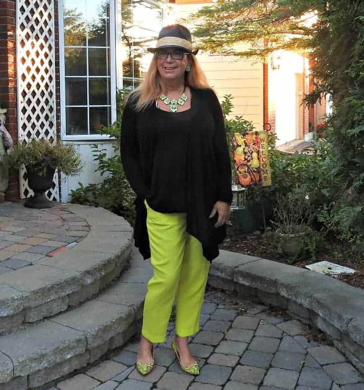 j crew neon pants, a fedora and paisley pumps