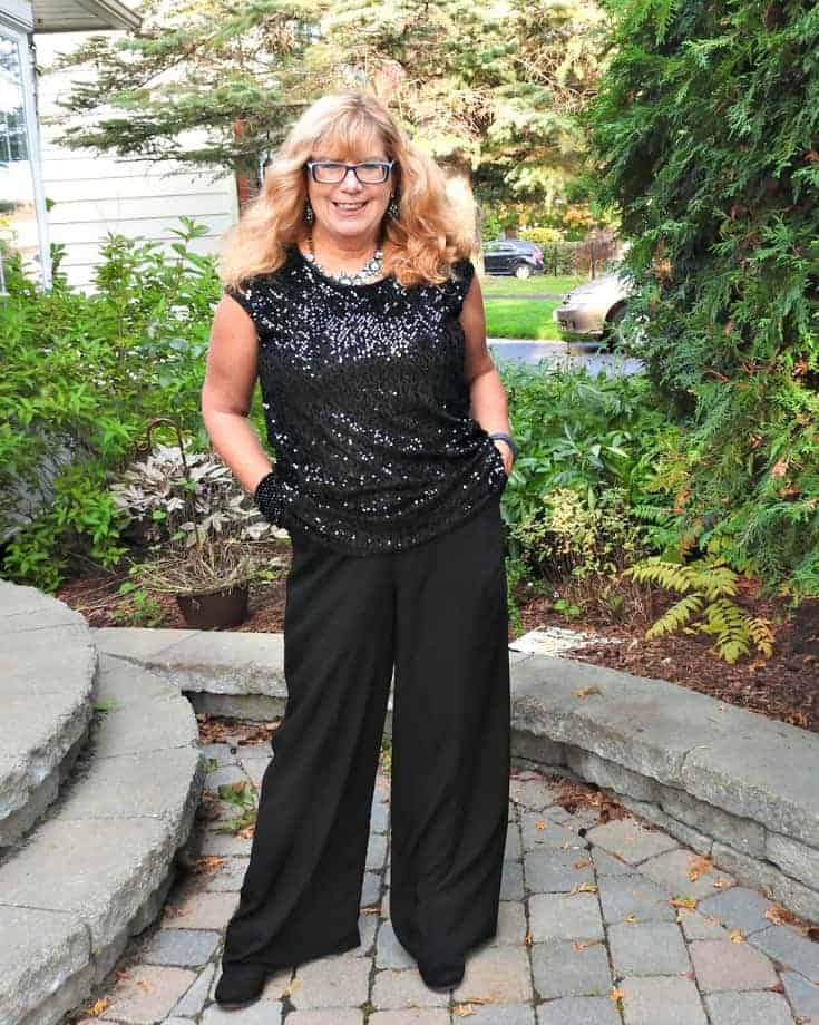 black Moto jacket, sequin top and palazzo pants with a wedge boot