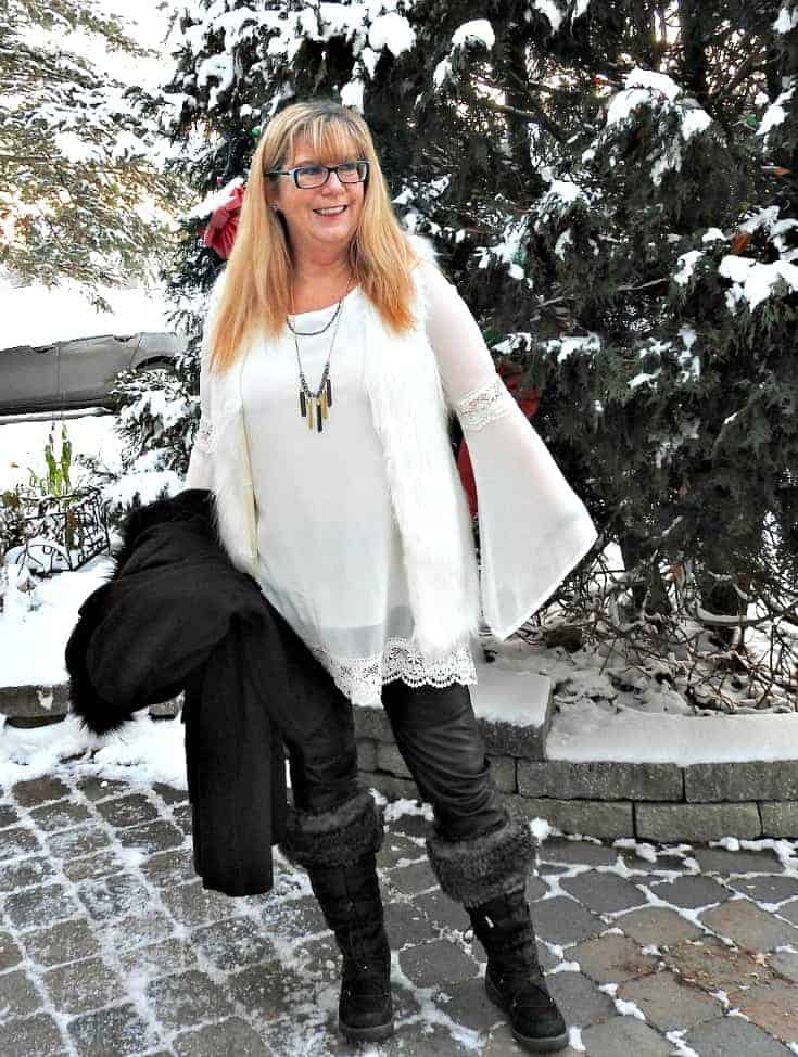 Tunic and white fur vest with a 7 charming sisters necklace, paired with leather leggings and my Cougar winter boots