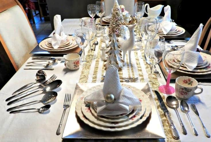 antique china and silver for a pink and gold christmas table