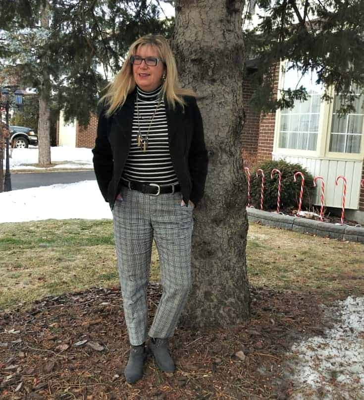 striped turtle neck and checked pants