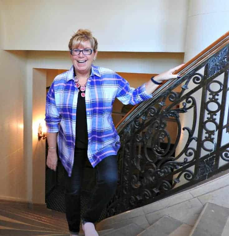 On the stairs in Old Navy Plaid and Haggar Dream Jeans with a Flaunt it 7 Charming Sisters necklace at the Chateau Laurier