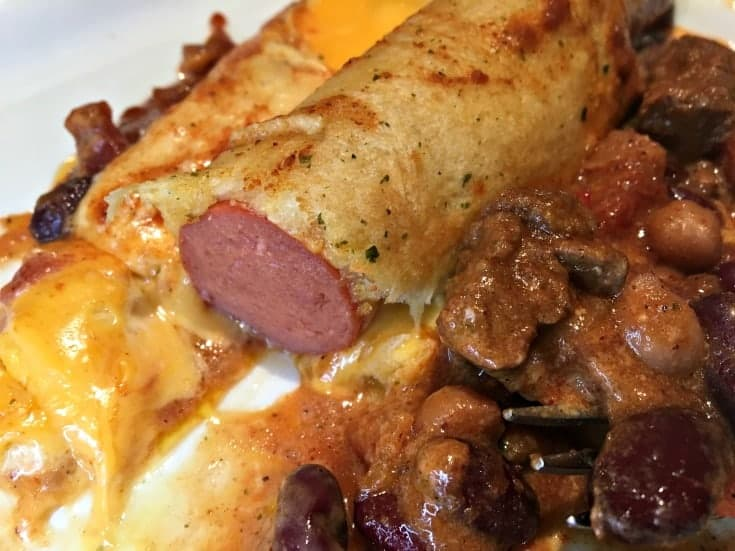 eating the Chili Cheese Hot Dog Croissant Bake