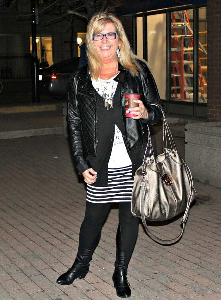 striped skirt, keyboard earrings and a black moto jacket with buckle boots