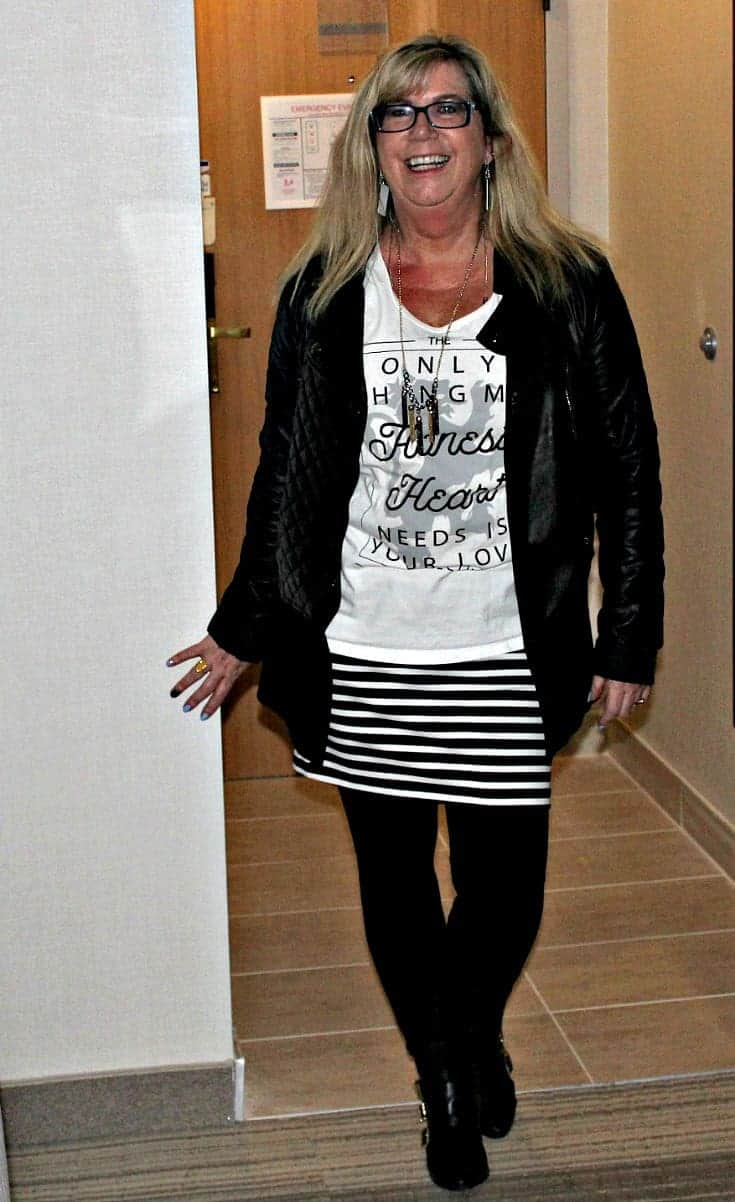 striped skirt, keyboard earrings and a black moto jacket and a white Honest Heart Collective Tank