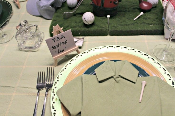 Fathers Day Golf Theme Table with green shirt napkins and fun tournament place cards